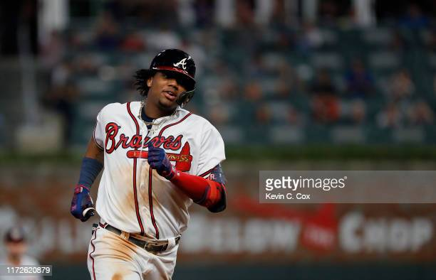 Ronald Acuna Jr. #13 of the Atlanta Braves rounds third base after hitting a solo homer in the fifth inning against the Washington Nationals at...