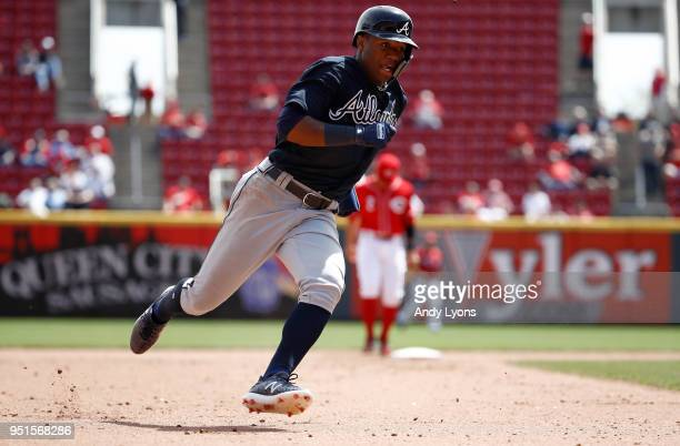 Ronald Acuna Jr #13 of the Atlanta Braves rounds third base on his way to score in the 8th inning against the Cincinnati Reds at Great American Ball...