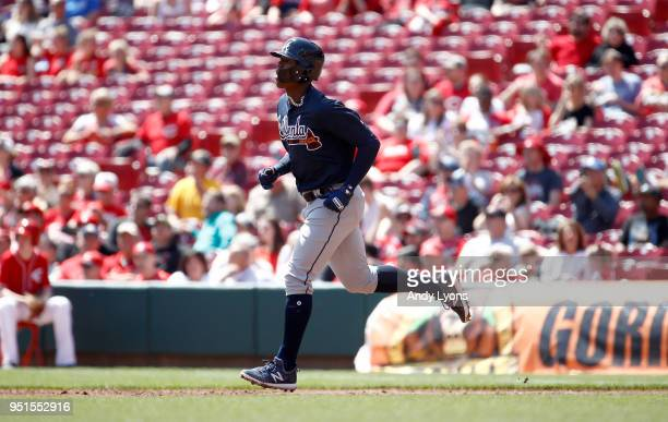 Ronald Acuna Jr #13 of the Atlanta Braves runs the bases after hitting his first MLB home run in the second inning against the Cincinnati Reds at...