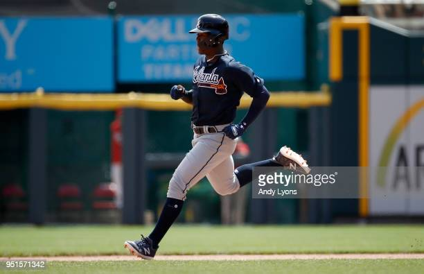 Ronald Acuna Jr #13 of the Atlanta Braves runs to second base for a double in the 8th inning against the Cincinnati Reds at Great American Ball Park...