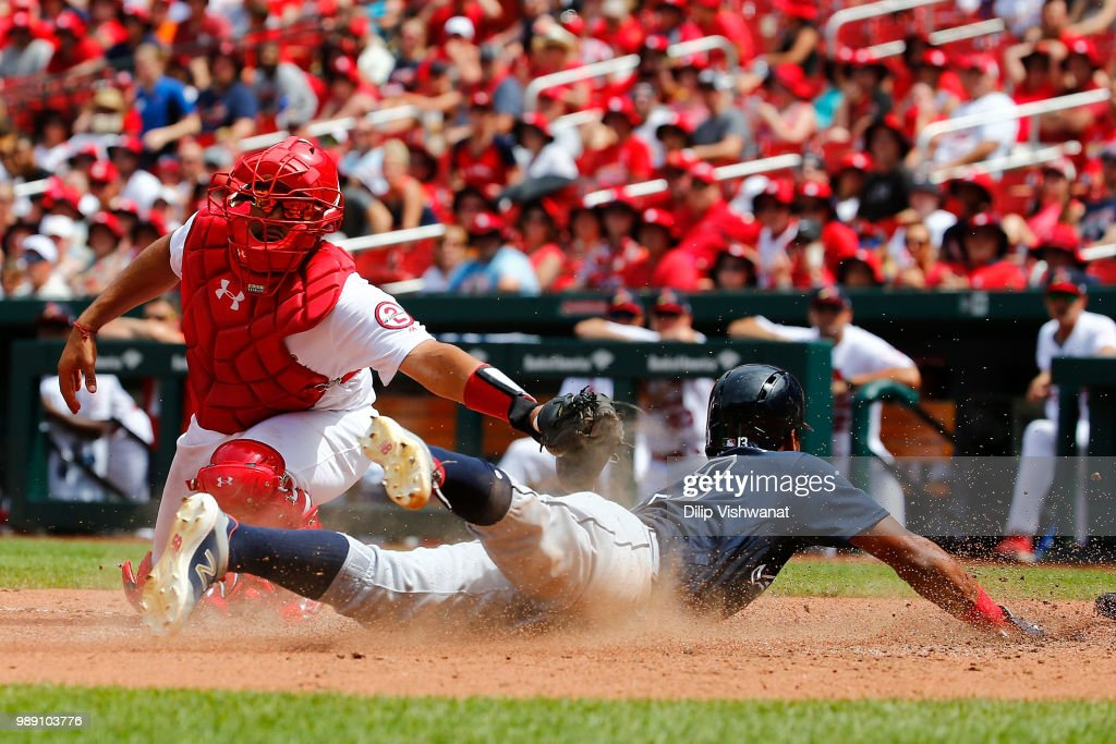Ronald Acuna Jr. #13 of the Atlanta Braves scores a run against Francisco Pena #46 of the St. Louis Cardinals in the sixth inning at Busch Stadium on July 1, 2018 in St. Louis, Missouri.