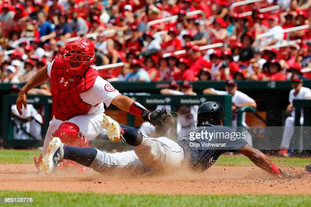 Ronald Acuna Jr #13 of the Atlanta Braves scores a run against Francisco Pena of the St Louis Cardinals in the sixth inning at Busch Stadium on July...