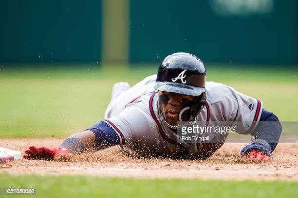 Ronald Acuna Jr #13 of the Atlanta Braves slides back to first base during the game against the Philadelphia Phillies at Citizens Bank Park on Sunday...