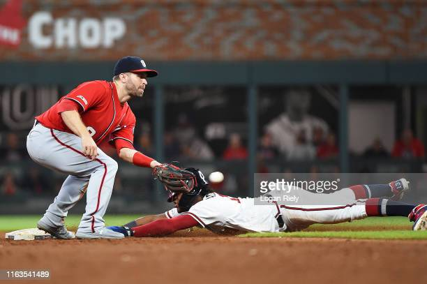 Ronald Acuna Jr. #13 of the Atlanta Braves slides into second base as Brian Dozier of the Washington Nationals fields the ball at SunTrust Park on...