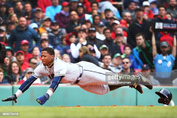 Ronald Acuna Jr #13 of the Atlanta Braves slides safely head first into home plate in the fifth inning of a game against the Boston Red Sox at Fenway...