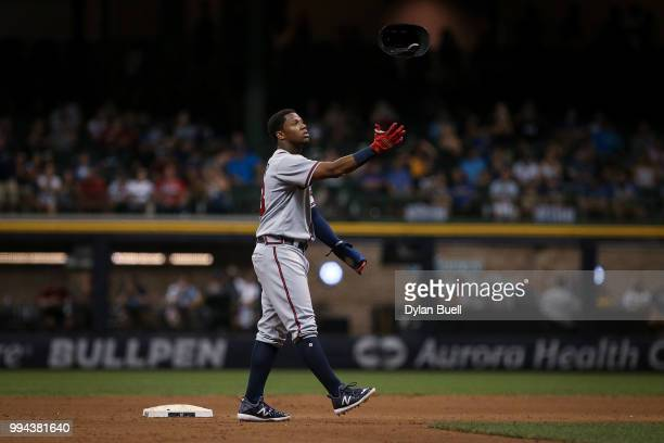 Ronald Acuna Jr #13 of the Atlanta Braves tosses his helmet in the seventh inning against the Milwaukee Brewers at Miller Park on July 5 2018 in...