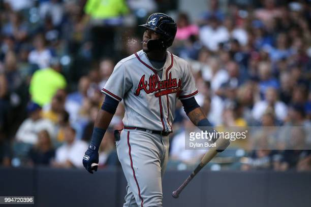 Ronald Acuna Jr #13 of the Atlanta Braves walks back to the dugout after striking out in the second inning against the Milwaukee Brewers at Miller...