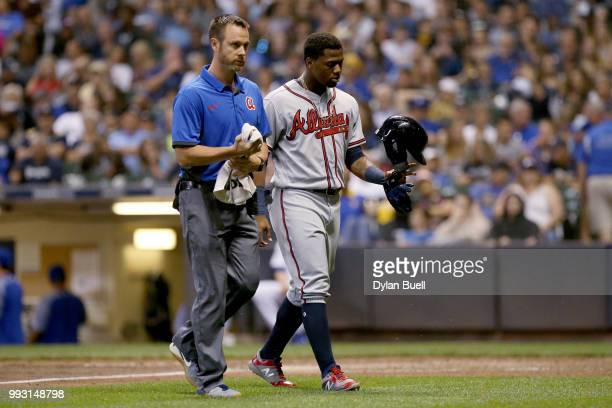 Ronald Acuna Jr #13 of the Atlanta Braves walks off the field after being injured in the seventh inning against the Milwaukee Brewers at Miller Park...
