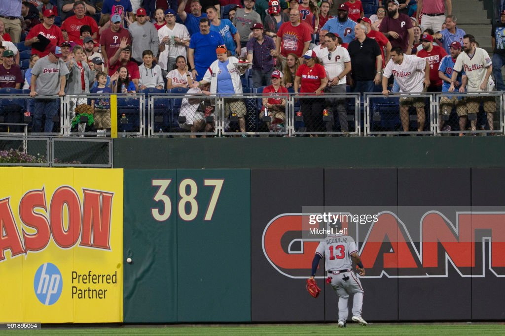 Ronald Acuna Jr. #13 of the Atlanta Braves watches a ball off the bat of Maikel Franco of the Philadelphia Phillies hit the wall for an RBI double in the bottom of the fifth inning at Citizens Bank Park on May 23, 2018 in Philadelphia, Pennsylvania. The Phillies defeated the Braves 4-0.