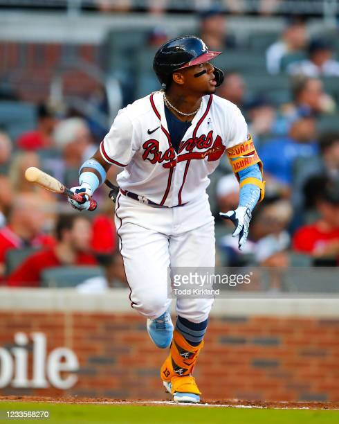 Ronald Acuna Jr. #13 of the Atlanta Braves watches the ball after hitting his 100th career home run in the third inning of game two of a doubleheader...