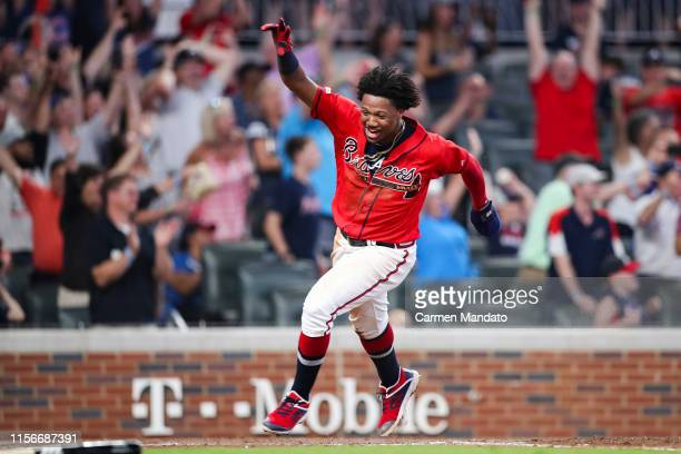 Ronald Acuna Jr #13 scores on a single from Josh Donaldson of the Atlanta Braves in the ninth inning during the game against the Washington Nationals...