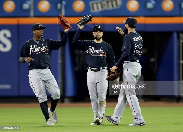 Ronald Acuna Jr. #13,Ender Inciarte and Nick Markakis of the Atlanta Braves celebrate the 7-0 win over the New York Mets on May 2, 2018 at Citi Field...