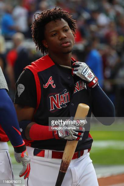 Ronald Acuna Jr. Of the Atlanta Braves and the National League looks on during Gatorade All-Star Workout Day at Progressive Field on July 08, 2019 in...