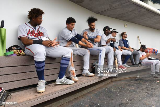 Ronald Acuna Luis Urias Lourdes Gurriel and Josh Tobias of Peoria Javelinas sit in the dugout in the Arizona Fall League game against the Mesa Solar...