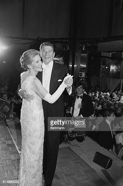 Ronald and Nancy Reagan, the newly inducted President and First Lady, dance at the National Museum of American History at the last stop on a tour of...