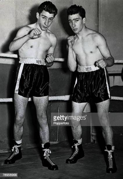 Ronald and Reginald Kray English gangsters who were born in London's East End and jailed in 1969 for murder in boxing pose circa 1960