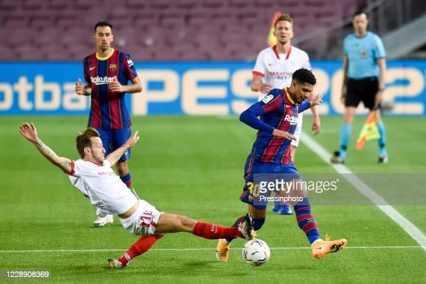 Ronald Araujo of FC Barcelona and Ivan Rakitic of Sevilla FC during the La Liga match between FC Barcelona and Sevilla FC played at Camp Nou Stadium...