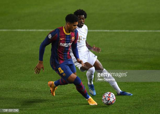Ronald Araujo of FC Barcelona is challenged by Somalia of Ferencvaros Budapest during the UEFA Champions League Group G stage match between FC...