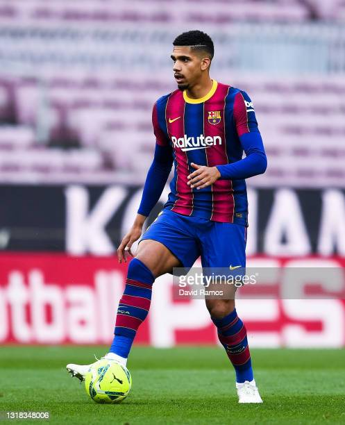 Ronald Araujo of FC Barcelona runs with the ball during the La Liga Santander match between FC Barcelona and RC Celta at Camp Nou on May 16, 2021 in...