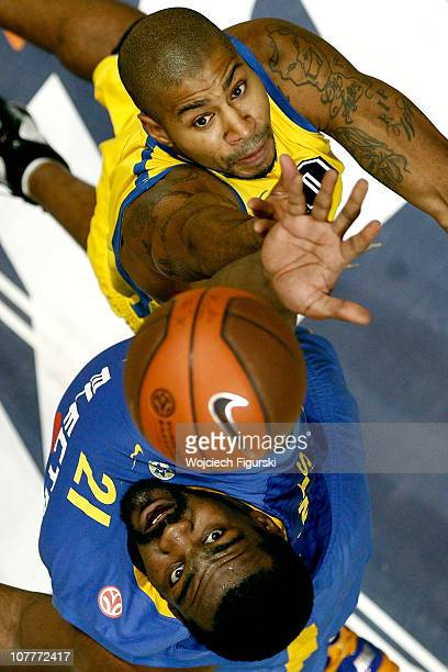 Ronald Burrell of Asseco Prokom Gdynia competes with Sofoklis Schortsanitis of Maccabi Electra Tel Aviv in action during the 20102011 Turkish...