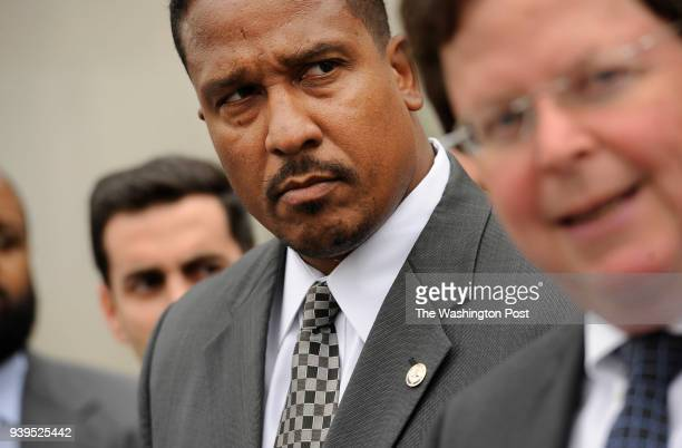 Ronald C Machen the United States Attorney for the District of Columbia center looks on as prosecutor Bruce Hegyi right speaks during a press...