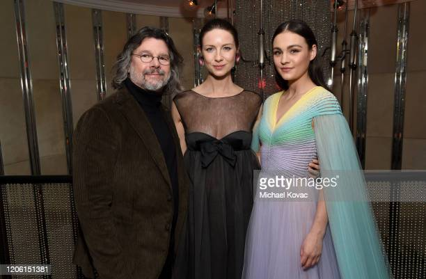 """Ronald D. Moore, Caitriona Balfe and Sophie Skelton attend the Starz Premiere event for """"Outlander"""" Season 5 at Beauty & Essex on February 13, 2020..."""