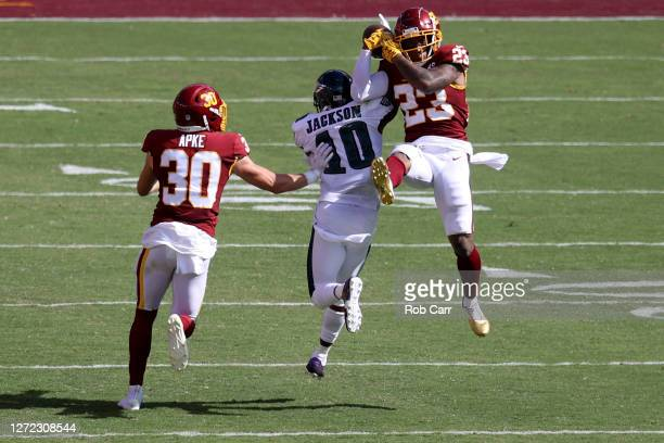 Ronald Darby and Troy Apke of the Washington Football Team break up a pass intended for DeSean Jackson of the Philadelphia Eagles in the second half...