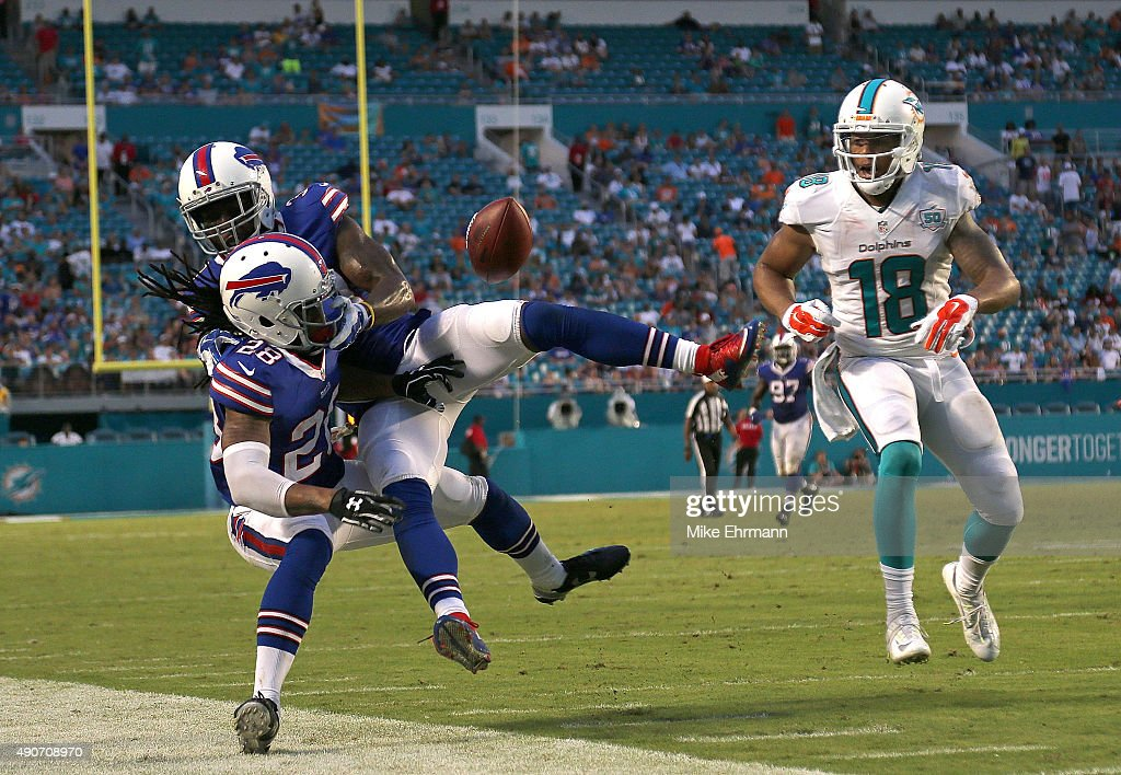 Ronald Darby #28 of the Buffalo Bills has an interception blocked by Bacarri Rambo #30 during a game against the Miami Dolphins at Sun Life Stadium on September 27, 2015 in Miami Gardens, Florida.