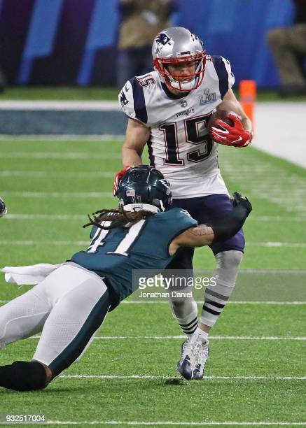Ronald Darby of the Philadelphia Eagles hits Chris Hogan of the New England Patriots during Super Bowl Lll at US Bank Stadium on February 4 2018 in...