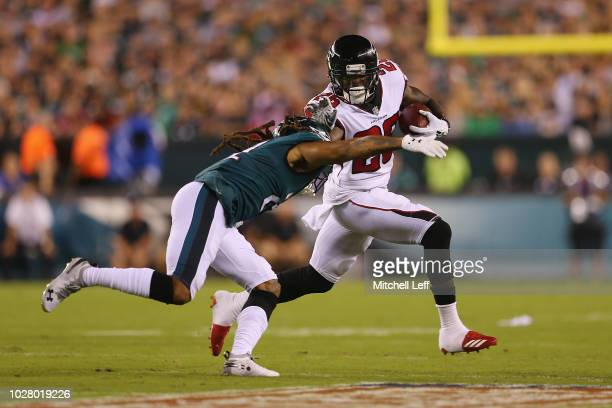 Ronald Darby of the Philadelphia Eagles tackles Tevin Coleman of the Atlanta Falcons during the first half at Lincoln Financial Field on September 6...