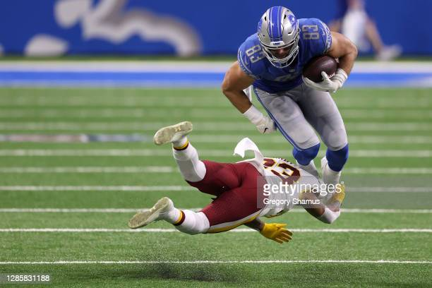 Ronald Darby of the Washington Football Team tackles Jesse James of the Detroit Lions following a completion during their game at Ford Field on...