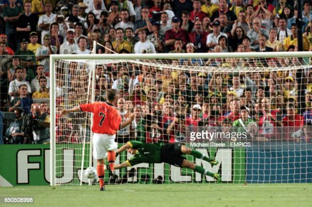 Ronald De Boer of Holland sees his penalty saved by Taffarel of Brazil