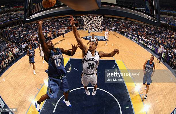 Ronald Dupree of the Minnesota Timberwolves goes to the basket against Dahntay Jones of the Memphis Grizzlies on April 11 2006 at the FedExForum in...