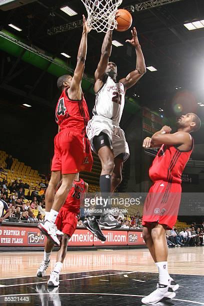 Ronald DuPree of the Utah Flash goes up for the shot against Kevin Burleson and Jamaal Tatum of the Idaho Stampede at McKay Events Center on March 09...