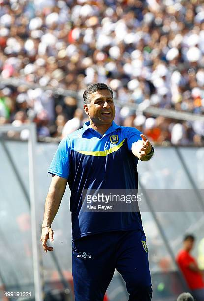 Ronald Fuentes head coach of U de Concepcion gives intructions to his players during a match between Colo Colo and U de Concepcion as part of 14th...