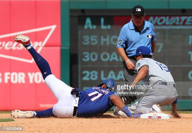 Ronald Guzman of the Texas Rangers beats a pickoff throw to Cheslor Cuthbert of the Kansas City Royals at second base in the fourth inning at Globe...