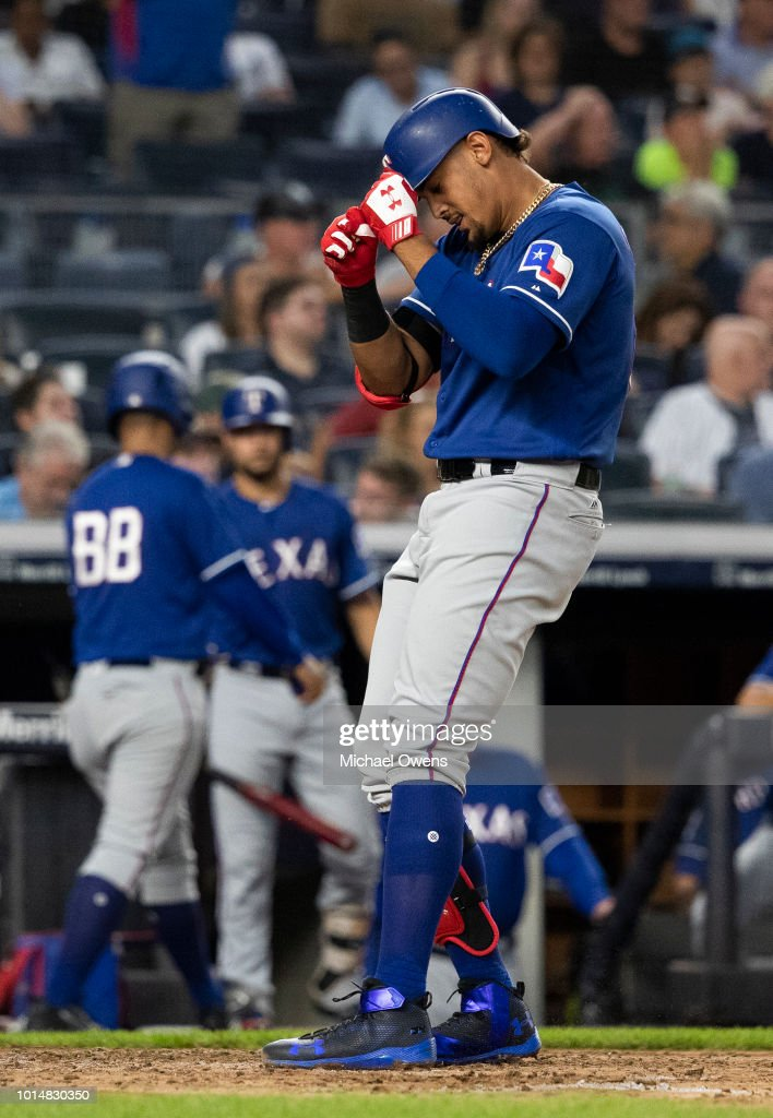 Ronald Guzman #67 of the Texas Rangers celebrates at home base after hitting a homerun in the fourth inning against the New York Yankees during their game at Yankee Stadium on August 10, 2018 in New York City.