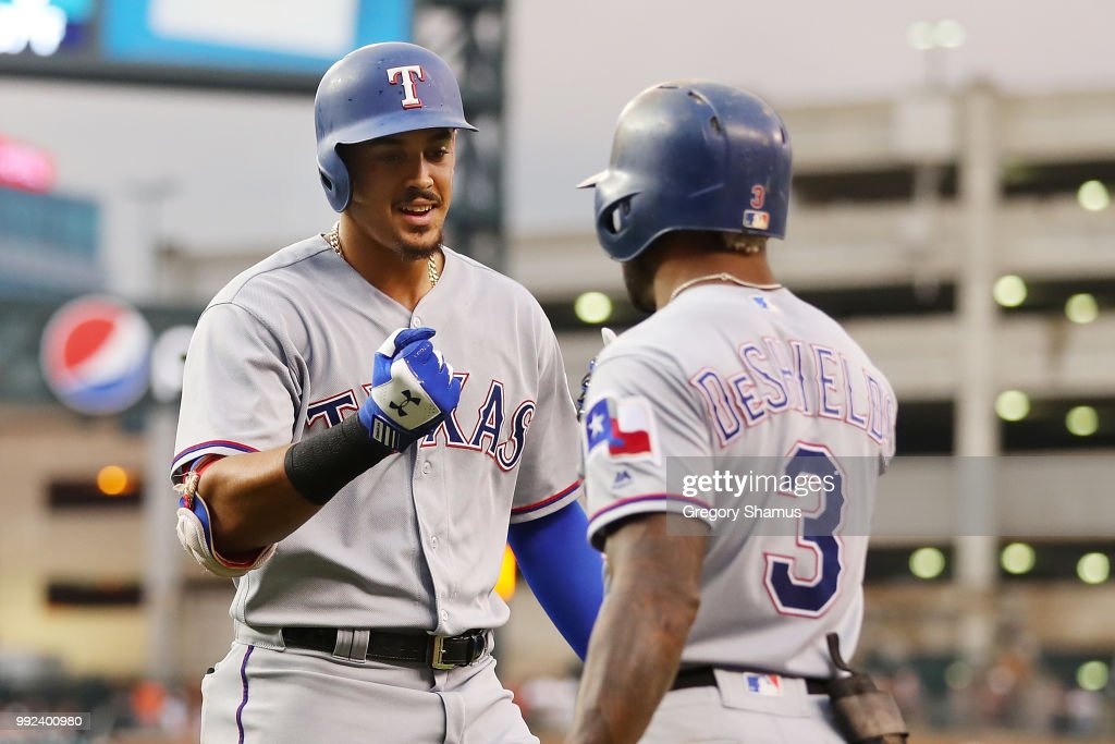 Ronald Guzman #67 of the Texas Rangers celebrates his two run fourth inning home run with Delino DeShields #3 while playing the Detroit Tigers at Comerica Park on July 5, 2018 in Detroit, Michigan.