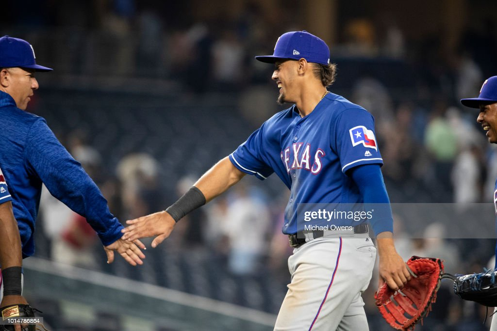 Ronald Guzman #67 of the Texas Rangers celebrates with teammates after the game against the New York Yankees during their game at Yankee Stadium on August 10, 2018 in New York City.
