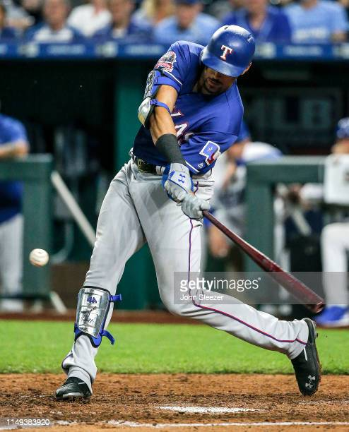 Ronald Guzman of the Texas Rangers connects on a two run home run in the sixth inning during the game against the Kansas City Royals at Kauffman...