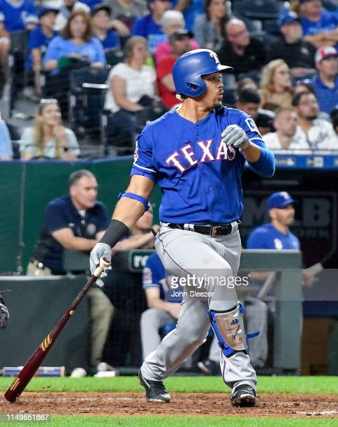 Ronald Guzman of the Texas Rangers follows through on a home run in the sixth inning during the game against the Kansas City Royals at Kauffman...