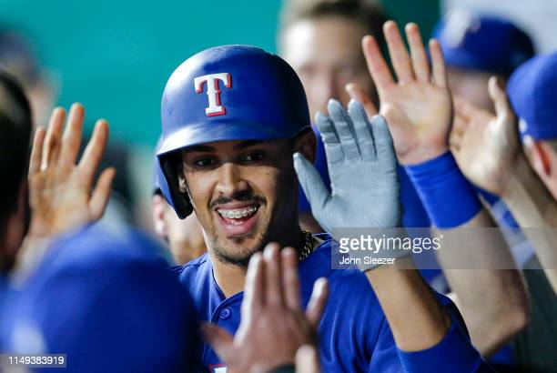 Ronald Guzman of the Texas Rangers is congratulated in the dugout after his two run home run in the sixth inning during the game against the Kansas...