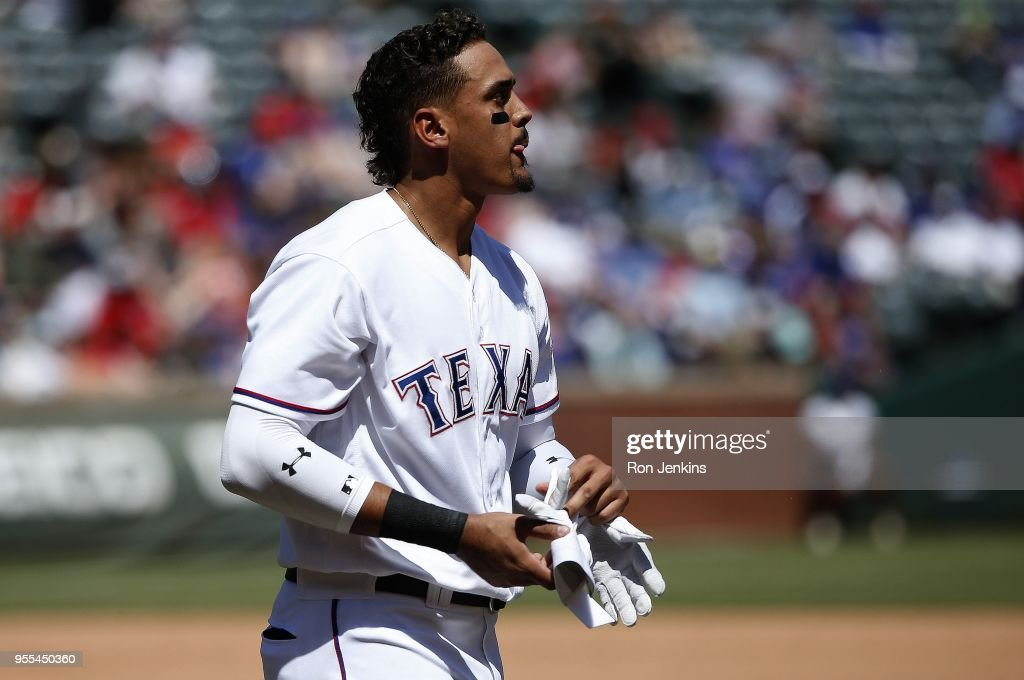 Ronald Guzman #67 of the Texas Rangers reacts after striking out against the Boston Red Sox during the fourth inning at Globe Life Park in Arlington on May 6, 2018 in Arlington, Texas. The Red Sox won 6-1.