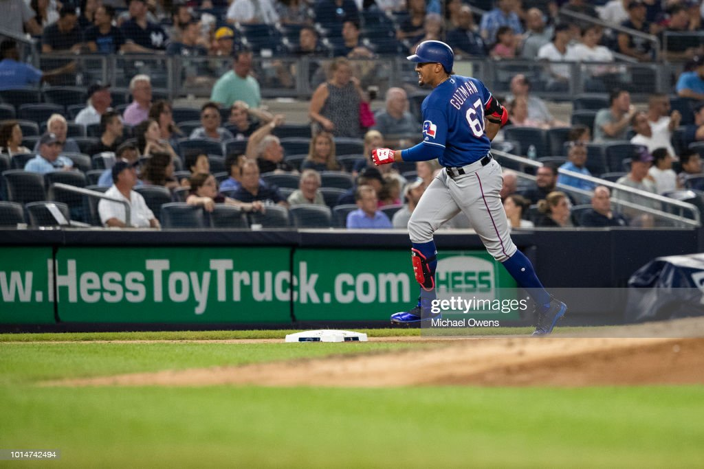 Ronald Guzman #67 of the Texas Rangers rounds the bases after hitting a homerun in the fourth inning against the New York Yankees during their game at Yankee Stadium on August 10, 2018 in New York City.