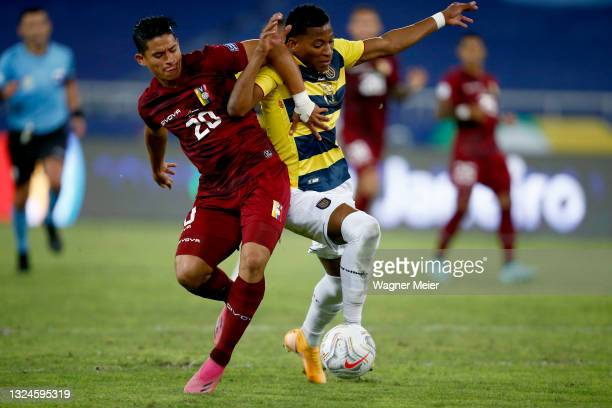 Ronald Hernandez of Venezuela competes for the ball with Gonzalo Plata of Ecuador during a Group B match between Venezuela and Ecuador as part of...