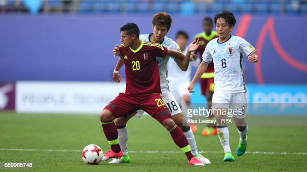 Ronald Hernandez of Venezuela holds off a challenge from Akito Takagi of Japan during the FIFA U20 World Cup Korea Republic 2017 Round of 16 match...
