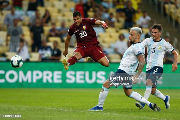 Ronald Hernandez of Venezuela kicks the ball in the air against Nicolas Otamendi and Nicolas Tagliafico of Argentina during the Copa America Brazil...