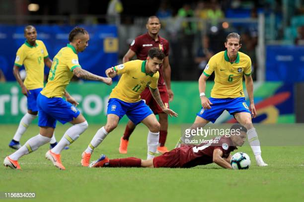 Ronald Hernández of Venezuela falls down as he fights for the ball with Philippe Coutinho of Brazil during the Copa America Brazil 2019 group A match...