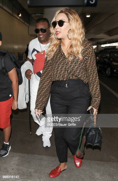 Ronald Isley and his wife, Kandy are seen on July 13, 2018 in Los Angeles, California.