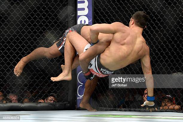 Ronald 'Jacare' Souza takes down Gegard Mousasi in their middleweight fight during the UFC Fight Night event inside the Grand Theatre at Foxwoods...